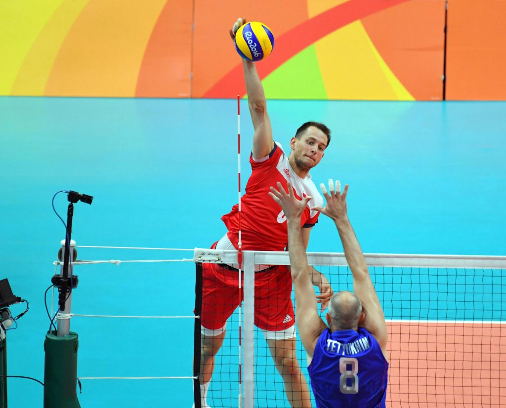 Bartosz Kurek of Poland spikes