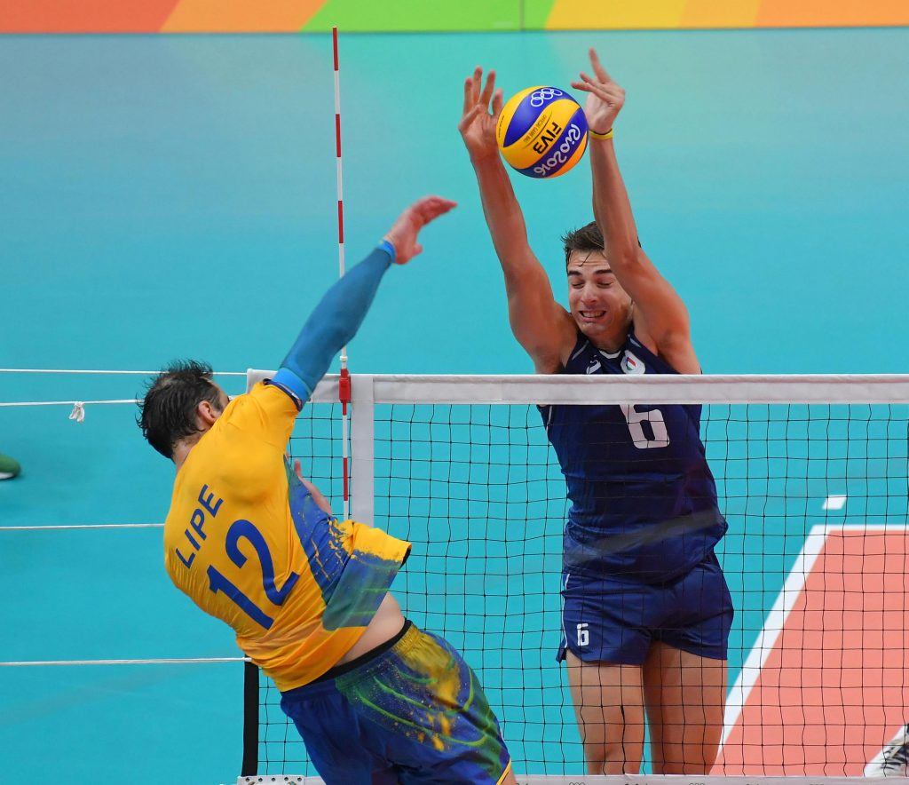 Luiz Felipe Marques Fonteles of Brazil spikes against Simone Giannelli of Italy blocks
